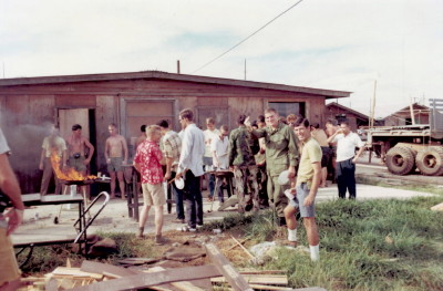 Get together behind the Officers Club. Right center, looking at the camera, is Don Long and Bob Goodspeed. Just to the right with white shirt is Ned Wilson