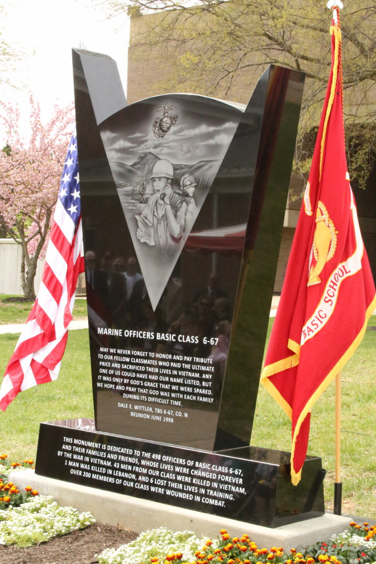 The 6-67 Memorial sits between the U.S. flag and the Marine Corps flag during the memorial's dedication at The Basic School on April 25, 2014